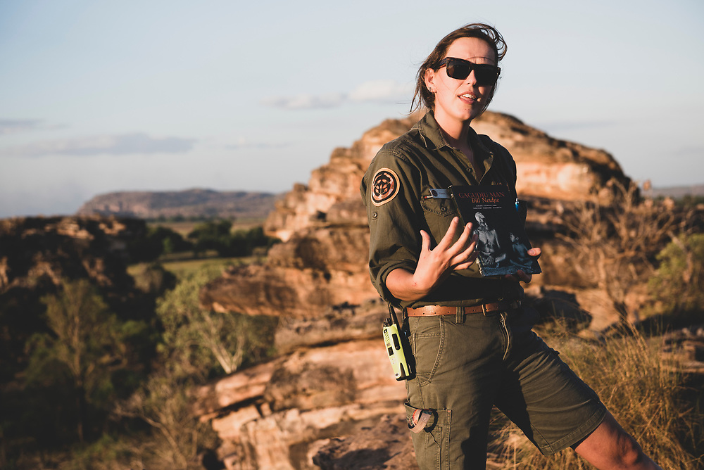 Kakadu National Park, Australia - September 5, 2017: Standing at Nadab lookout in Ubirr, at Kakadu National Park in Australia's Northern Territory, Phoebe Reeve, a ranger for Parks Australia, speaks to visitors about the late Bill Neidjie. An indigenous Australian and Bunitj elder, Bill Neidjie died in 2002 but left behind traditional wisdom like this:<br />  <br /> Earth<br /> Like your father or brother or mother<br /> because you born from Earth.<br /> You got to come back to Earth.<br /> When you dead, you'll come back to Earth.<br /> Maybe little while yet…then you'll come back to Earth.<br /> That's your bone, your blood.<br /> It's in this Earth, same as for tree.<br /> <br /> And also like this:<br /> <br /> My people...Not many...<br /> We getting too old.<br /> Young people. I don't know if they can hang onto this story.<br /> But now you know the story...<br /> ...You responsible now.<br /> You got to go with us. To Earth.<br /> Might be you can hang on, hang onto this story.<br /> To this Earth.