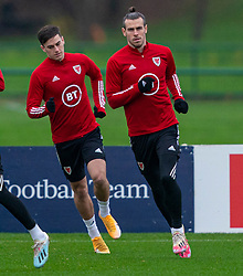 CARDIFF, WALES - Tuesday, November 17, 2020: Wales' Tom Lawrence (L) abd captain Gareth Bale during a training session at the Vale Resort ahead of the UEFA Nations League Group Stage League B Group 4 match between Wales and Finland. (Pic by David Rawcliffe/Propaganda)