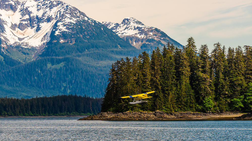 A float plane taking off from the waters off Pack Creek, Admiralty island, Inside Passage, southeast Alaska USA.