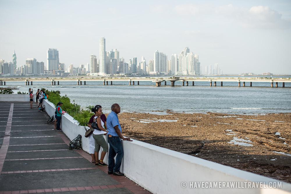 People enjoying the waterfront boardwalk in Casco Viejo in Panama City, Panama.