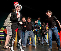 """Catherine McLaughlin as """"The Cat in the Hat"""" along with the Wickersham Brothers during dress rehearsal for Gilford Middle School's production of """"Seussical"""" at the GHS auditorium Thursday, Friday and Saturday nights at 7pm with a matinee show Saturday at 2pm.  (Karen Bobotas/for the Laconia Daily Sun)"""