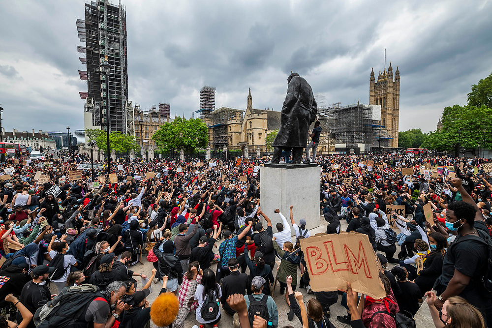 The march ends up in Parliament Square with taking a knee and fist raising in salute - Protesters respond to the the death of George Floyd, in Minneapolis last week, by gathering in Hyde Park as part of a day of action against discrimination. The 46-year-old African American was filmed as a white police officer kneeled on his neck for almost nine minutes.  The eased 'lockdown' continues for the Coronavirus (Covid 19) outbreak in London.