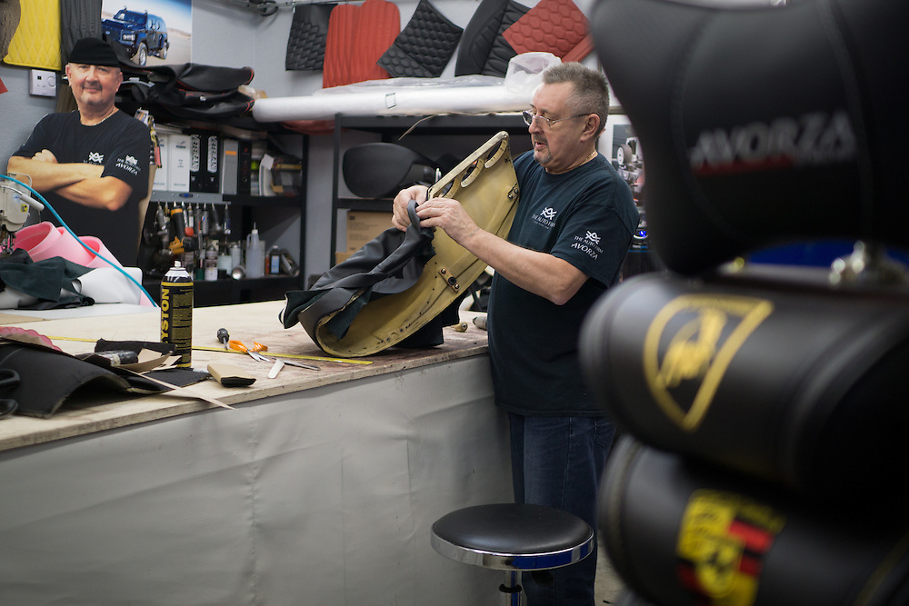 DORAL, FLORIDA, DECEMBER 11, 2015<br /> David Davydov, works in the hand stitched interiors for a vehicle in the shop at The Auto Firm, a South Florida car customizing and restoring shop which has a vast clientele of professional athletes and entertainers.<br /> (Photo by Angel Valentin/Freelance)