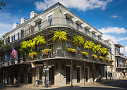 """The French Quarter, also known as the Vieux Carré, is the oldest neighborhood in the city of New Orleans. When New Orleans (La Nouvelle-Orléans in French) was founded in 1718 by Jean-Baptiste Le Moyne de Bienville, the city was originally centered on the French Quarter, or the Vieux Carré (""""Old Square"""" in French) as it was known then. While the area is still referred to as the Vieux Carré by some, it is more commonly known as the French Quarter today, or simply """"The Quarter."""" The district as a whole is a National Historic Landmark, and contains numerous individual historic buildings. It was affected relatively lightly by Hurricane Katrina in 2005, as compared to other areas of the city and the greater region."""