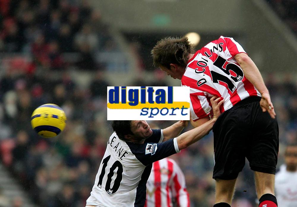Photo: Andrew Unwin.<br /> Sunderland v Tottenham Hotspur. The Barclays Premiership. 12/02/2006.<br /> Tottenham's Robbie Keane (L) keeps Sunderland's Danny Collins (R) at arms length.