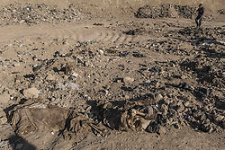 November 19, 2016 - Hammam Al-Alil, Nineveh Governorate, Iraq - Dead bodies of mass graves in a dump atHammam al-Alil, Iraq. (Credit Image: © Berci Feher via ZUMA Wire)
