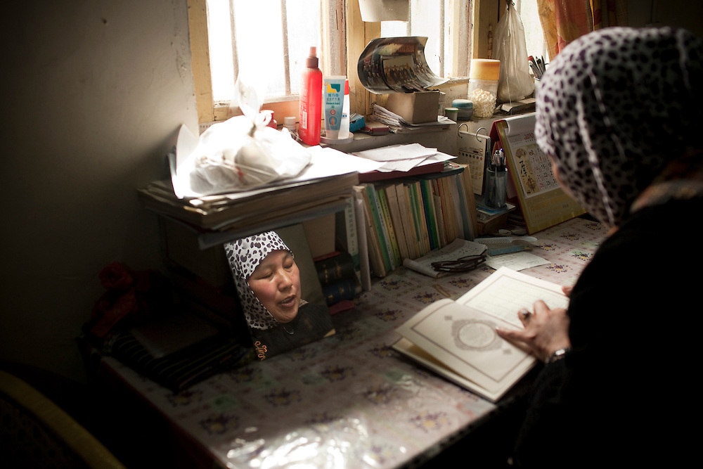 """Yao Baoxia's main role is as a teacher, she says.<br /> <br /> """"When people come to pray, they don't know how to chant the Quran, so my job is teaching people about Islam, helping them to study one line at a time and leading the prayers,"""" she says."""