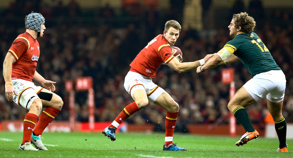 Wales' Liam Williams brushes off South Africa's Rohan Janse van Rensburg<br /> <br /> Photographer Simon King/CameraSport<br /> <br /> International Rugby Union Friendly - Wales v South Africa - Saturday 26th November 2016 - Principality Stadium - Cardiff<br /> <br /> World Copyright © 2016 CameraSport. All rights reserved. 43 Linden Ave. Countesthorpe. Leicester. England. LE8 5PG - Tel: +44 (0) 116 277 4147 - admin@camerasport.com - www.camerasport.com