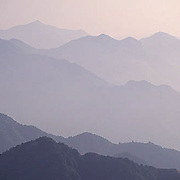 China, Yellow mountains shrouded in fog.