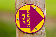 Macro close up of Restricted Byway sign on fencepost, Sutton, Suffolk, UK