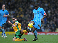Photo: Ashley Pickering.<br />Norwich City v Coventry City. Coca Cola Championship. 24/02/2007.<br />Simon Lappin of Norwich (L) tackles Isaac Osbourne of Coventry
