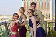 Samantha Terry takes a picture with Kristin Tuori, Sarah Monroe and Lucas Alden as Fairdale High School holds it's prom at the Muhammad Ali Center on Saturday, May 18.