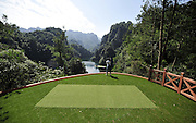 "ZHANGJIAJIE, CHINA - SEPTEMBER 23: (CHINA OUT) <br /> <br /> <br /> ""Extreme 19th-Golf Hole""<br /> <br /> A worker of Korea experiences golf on the tee of ""Extreme 19th-Golf Hole"" on September 23, 2014 in Zhangjiajie, Hunan province of China. A 200-meter long ""Extreme 19th-Golf Hole"" was established at Baofeng Lake Scenic Area of Zhangjiajie whose 248-square-mters tee is atop a 80-meter cliff with its putting green floating on Baofeng lake. The first ""Extreme 19th-Golf Hole"" challenge race.<br /> ©Exclusivepix"