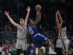 November 15, 2018 - Los Angeles, California, U.S - Lou Williams #23 of the Los Angeles Clippers takes a shot between Davis Bertans #42 and Bryn Forbes #11 of the San Antonio Spurs during their NBA game on Thursday November 15, 2018 at the Staples Center in Los Angeles, California. Clippers defeat Spurs, 116-111. (Credit Image: © Prensa Internacional via ZUMA Wire)
