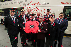 Pictured: Hugh Crawford, Willie Hamilton, John Allen, Fred Collins, Fred Donnelly, Willie Potter, Simon Allbut, John Adamson joined Gordon Michie from Poppy Scotland to launch the bus.<br /> <br /> Lothian Buses launches its 'Poppy Bus'. The vehicle, which is white with quotes from well-known war poems painted on it, will run on various routes throughout November. Ex-Forces staff and Poppy Scotland head of fundraising Gordon Michie were there to give it a good send off<br /> <br /> Ger Harley | EEm 27 October 2016