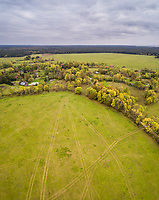 Aerial view of pathway patterns in the green field on the island of Vormsi, Estonia