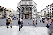 Battistero in Piazza San Giovanni with early morning tourists Florence Italy