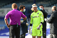 Football - 2020 / 2021 Sky Bet League One - Portsmouth vs. MK Dons<br /> <br /> Portsmouth's Craig MacGillivray receives some treatment and a bandage to cover up a cut to his head during the League One fixture at Fratton Park <br /> <br /> COLORSPORT/SHAUN BOGGUST