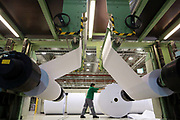 Workers operate on the paper production line at the UPM Changshu Paper Mill in Changshu, Jiangsu Province, China on 23 July 2012. UPM Changshu is the single largest investment by a Finnish company in China.