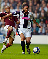 Photo: Leigh Quinnell.<br /> West Bromwich Albion v Arsenal. The Barclays Premiership.<br /> 15/10/2005. Arsenals Gael Clichy flys into West Broms Jonathan Greening.