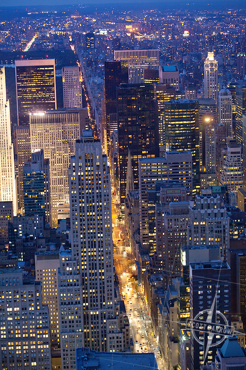 View of Fifth Avenue and Midtown Manhattan from the Empire State Building Observation Deck at night.