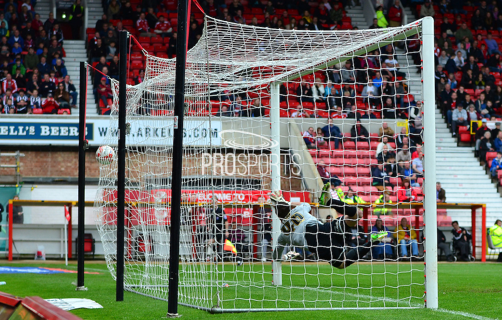 Alex Cisak can not stop Anton Rodgers free kick during the Sky Bet League 1 match between Swindon Town and Leyton Orient at the County Ground, Swindon, England on 3 May 2015. Photo by Alan Franklin.