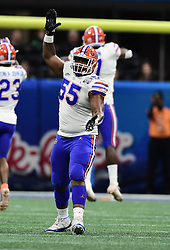 Florida Gators defensive tackle Kyree Campbell (55) reacts after a play during the Chick-fil-A Bowl Game at  the Mercedes-Benz Stadium, Saturday, December 29, 2018, in Atlanta. ( Kyle Hess via Abell Images for Chick-fil-A Kickoff)