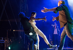 © Licensed to London News Pictures.  02/09/2017; Bristol, UK. WARNING, NUDITY: A male streaker invades the stage as ELBOW with singer GUY GARVEY performs at The Downs Festival 2017 on The Downs in Bristol. Guy Garvey then takes the streaker's hand and embraces the streaker. Picture credit : Simon Chapman/LNP