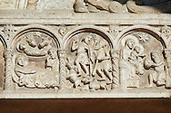 Scenes from the life of Christ, the work of the sculptor Nicholaus, on the main portal  of the 12th century Romanesque Ferrara Duomo, Italy . Ferrara Cathedral (Basilica Cattedrale di San Giorgio, Duomo di Ferrara) is a Roman Catholic cathedral and minor basilica in Ferrara, Northern Italy. The original Romanesque design of Ferrara Cathedral is manifest in the façade. In the centre of the façade of Ferrara Cathedral is a porch, supported by two columns with Atlases seated on lions at the bases. It is decorated with a Last Judgement by an unknown master and a loggia with a Madonna and Child (a late Gothic addition). The portal of Ferrara Cathedral is the work of the sculptor Nicholaus, a pupil of Wiligelmus. The lunette shows Saint George, patron saint of Ferrara, slaying the dragon; scenes from the Life of Christ appear on the lintel. The jambs framing the entrance of Ferrara Cathedral are embellished with figures depicting the Annunciation and the four prophets who foretold the coming of Christ.<br /> <br /> Visit our ITALY PHOTO COLLECTION for more   photos of Italy to download or buy as prints https://funkystock.photoshelter.com/gallery-collection/2b-Pictures-Images-of-Italy-Photos-of-Italian-Historic-Landmark-Sites/C0000qxA2zGFjd_k<br /> <br /> If you prefer to buy from our ALAMY PHOTO LIBRARY  Collection visit : https://www.alamy.com/portfolio/paul-williams-funkystock/ferrara.html .