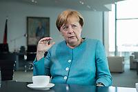 23 AUG 2017, BERLIN/GERMANY:<br /> Angela Merkel, CDU, Bundeskanzlerin, waehrend einem Interview, in Ihrem Buero, Bundeskanzleramt<br /> IMAGE: 20170823-02-001<br /> KEYWORDS: Büro
