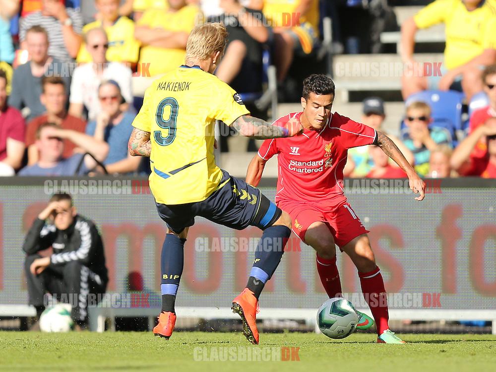 FODBOLD: Philippe Coutinho (Liverpool) udfordrer Thomas Kahlenberg (Brøndby) under træningskampen mellem Brøndby IF og Liverpool FC den 16. juli 2014 på Brøndby Stadion. Foto: Claus Birch