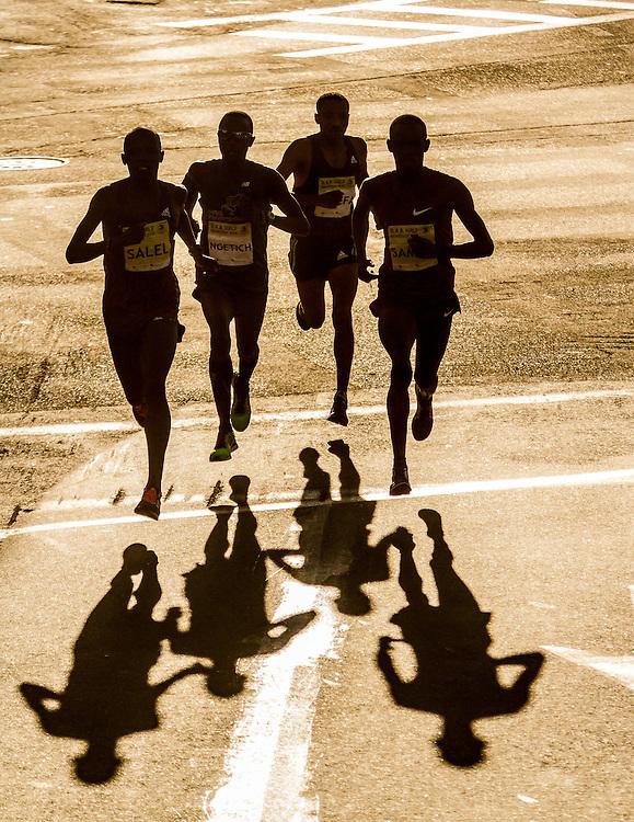 leaders Sambu, Salel, Ngetich and Assefa fly down road near 1 mile mark