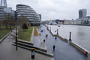 With very few people out and about the scene at More London near to City Hall is one of quiet on the riverside walkway as the national coronavirus lockdown three continues on 28th January 2021 in London, United Kingdom. Following the surge in cases over the Winter including a new UK variant of Covid-19, this nationwide lockdown advises all citizens to follow the message to stay at home, protect the NHS and save lives.