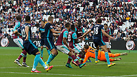 Football - 2016 / 2017 Premier League - West Ham United vs. Middesborough <br /> <br /> Adrian of West Ham dives low through a mass of players to punch clear at The London Stadium.<br /> <br /> COLORSPORT/DANIEL BEARHAM