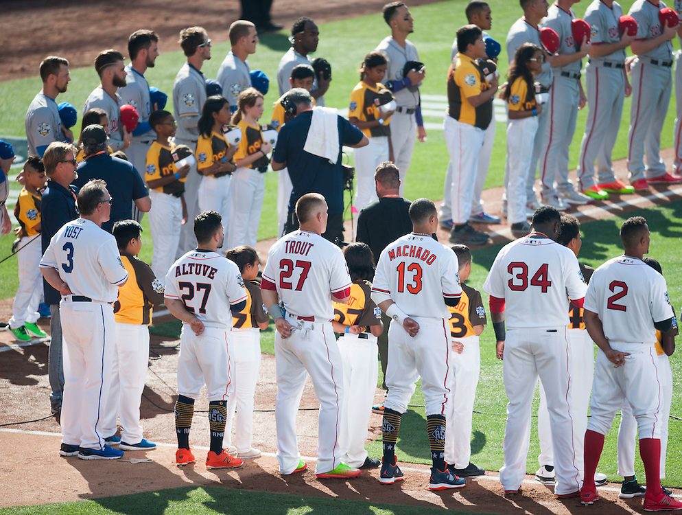 Mike Trout joins the American League roster for the National Anthem during the 2016 MLB All-Star Game at Petco Park in San Diego on Tuesday.<br /> <br /> ///ADDITIONAL INFO:   <br /> <br /> allstar.0713.kjs  ---  Photo by KEVIN SULLIVAN / Orange County Register  -- 7/12/16<br /> <br /> The 2016 MLB All-Star Game at Petco Park in San Diego.