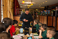Ricky and Jonathan order their lunch with servor Antonio Leon in Spanish at the Restaurante El Jimador Thursday afternoon during Holy Trinity School's field trip with fellow 4th and 5th graders from Mrs. McKinney's Spanish class.  (Karen Bobotas/for the Laconia Daily Sun)