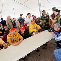 081414  Adron Gardner<br /> <br /> Photojournalist Kenji Kawano photographs Navajo Code Talkers during Code Talker day in Window Rock Thursday.