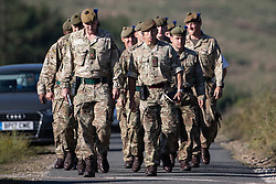 "© Licensed to London News Pictures . 28/06/2018 . Saddleworth , UK . Soldiers arrive at Higher Swineshaw Reservoir . The army are being called in to support fire-fighters , who continue to work to contain large wildfires spreading across Saddleworth Moor and affecting people across Manchester and surrounding towns . Very high temperatures , winds and dry peat are hampering efforts to contain the fire , described as "" unprecedented "" by police and reported to be the largest in living memory . Photo credit: Joel Goodman/LNP"