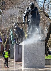 © Licensed to London News Pictures. 12/03/2020. London, UK. Deep clean for Winston Churchill statue in Parliament Square which is normally full of tourists doing selfies appears very quiet this afternoon as the World Health Organization declares that the Coronavirus disease a Pandemic, US President Donald Trump bans all travel from Europe except the UK and Prime Minister Boris Johnson holds a Cobra meeting as fears over the Coronavirus continues. Photo credit: Alex Lentati/LNP