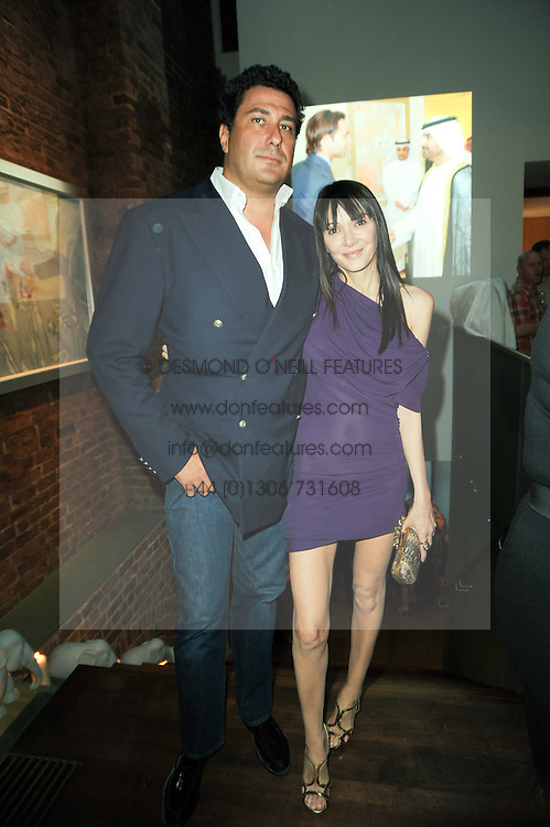 EDUARDO TEODORANI-FABBRI and ANNABELLE NEILSON at a private view of Sacha Jafri's paintings entitled 'London to India' held in aid of The Elephant Family charity at 23 Macklin Street, Covent Garden, London on 3rd June 2010.