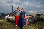 Jacob Lucas (red) and his brother Jeremy Lucas (blue) in front of Jacob's race car at Salina High Banks Speedway.