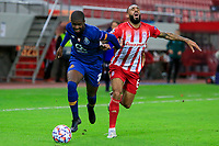 PIRAEUS, GREECE - DECEMBER 09: Nanu of FC Porto and Yann M'Vila of Olympiacos FC during the UEFA Champions League Group C stage match between Olympiacos FC and FC Porto at Karaiskakis Stadium on December 9, 2020 in Piraeus, Greece. (Photo by MB Media)
