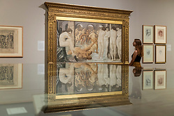 """© Licensed to London News Pictures. 22/10/2018. LONDON, UK. A staff member views """"Venus Discordia"""", 1872-3, by Edward Burne-Jones.  Preview of the largest Edward Burne-Jones retrospective to be held in a generation at Tate Britain.  Burne-Jones was a pioneer of the symbolist movement and the only Pre-Raphaelite to achieve world-wide recognition in his lifetime.  The exhibition runs 24 October to 24 February 2019.  Photo credit: Stephen Chung/LNP"""