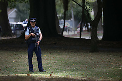 March 17, 2019 - Christchurch, New Zealand - An armed police officer stands guard outside Masjid Al Noor mosque after Friday's mosque attacks in Christchurch on March 16, 2019. At least 49 people dead and more than 40 people injured following attacks on two mosques in  Christchurch. The national security threat level has been increased from low to high for the first time in New Zealand's history after this attack. (Credit Image: © Sanka Vidanagama/NurPhoto via ZUMA Press)