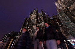 Cologne, Germany, Jan. 2012 -  Pedestrians navigate stairs in front of the Cologne Dom Cathedral in Cologne, Germany. Officially, Hohe Domkirche St. Peter und Maria (or The High Cathedral of Saints Peter and Mary), is a Roman Catholic church in Cologne, Germany. It is the seat of the Archbishop of Cologne and the administration of the Archdiocese of Cologne. It is renowned monument of German Catholicism and Gothic architecture and is a World Heritage Site. It is Germany's most visited landmark, attracting an average of 20,000 people a day. The Cologne Cathedral was built between 1248 and 1880. It is 144.5 meters (474 ft) long, 86.5 m (284 ft) wide and its towers are approximately 157 m (515 ft) tall. The cathedral is the largest Gothic church in Northern Europe and has the second-tallest spire and largest facade of any church in the world. The choir has the largest height to width ratio of any medieval church. (Photo © Jock Fistick)