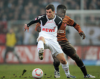 Fotball<br /> Tyskland<br /> 29.01.2011<br /> Foto: Witters/Digitalsport<br /> NORWAY ONLY<br /> <br /> v.l. Mato Jajalo (Koeln), Gerald Asamoah<br /> Bundesliga, FC St. Pauli - 1. FC Köln 3:0