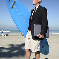 """From """"The Green Executive"""" photo series, all about a successful CEO who surfs and makes a conscious effort to care for the environment.  He's an alternative commuter, board director, and gives a whole new meaning to """"wetsuit"""". He's a real great boss who hires tele-commuters and flex-hour employees. He re-defines the stereotypical surfer of today. He speaks for and to the green demographic of environmental awareness, alternative commuting, healthy work/play balance, businesses going green, and """"do what you love, love what you do.""""  And you can feel good about licensing this image too -a  portion of the proceeds will be donated to Surfrider Foundation."""