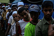 BAYEUN, ACEH, INDONESIA - JULY 11 : <br /> Rohingya migrant stand and lines to received food from volunteer to break fasting at temporary shelter camp in Bayeun, East Aceh, Indonesia on July 11. 2015. The boatpeople in Aceh are among thousands of Rohingya and Bangladeshi migrants who arrived in countries across Southeast Asia in May after a Thai crackdown threw the people-smuggling trade into chaos.<br /> ©Nira Cahaya/Exclusivepix Media