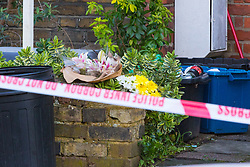 Floral tributes have been laid as police continue to investigate at the the house where the body of French film producer 34-year-old Laureline Garcia-Bertaux was found buried in a shallow grave at an address in Kew, London, after she was reported missing on Tuesday march 5th 2019. London, March 10 2019.