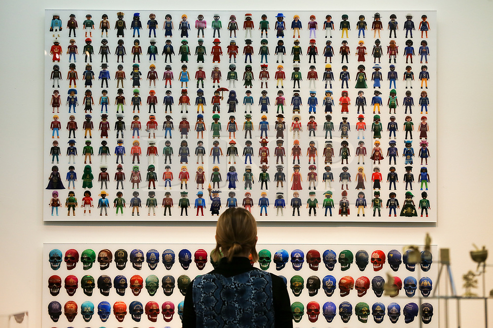 © Licensed to London News Pictures. 21/01/2020. London, UK. A woman views Yanko Tihov's artwork during the preview of London Art Fair at Business Design Centre in north London. The fair opens on 22 January and runs until 26 January, which showcases modern and contemporary artwork from galleries around the world. Photo credit: Dinendra Haria/LNP